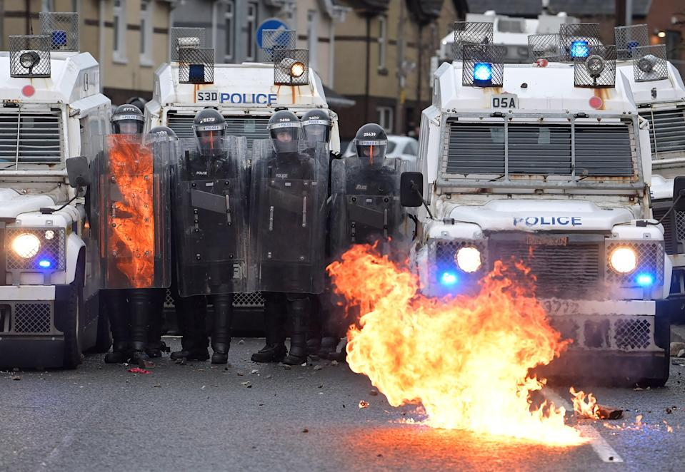 <p>Nationalists attack police on Springfield Road just up from peace wall interface gates, which divide the nationalist and loyalist communities</p> (Getty)