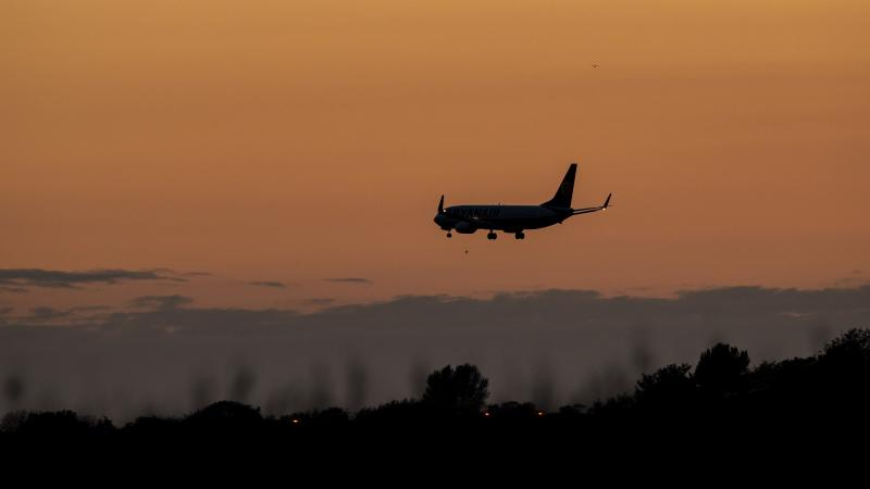 Minister criticised over comments about flying in face of climate crisis