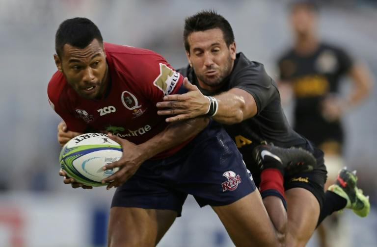 Queensland Reds fullback Aidan Toua (left) is tackled by Jaguares centre Santiago Iglesias