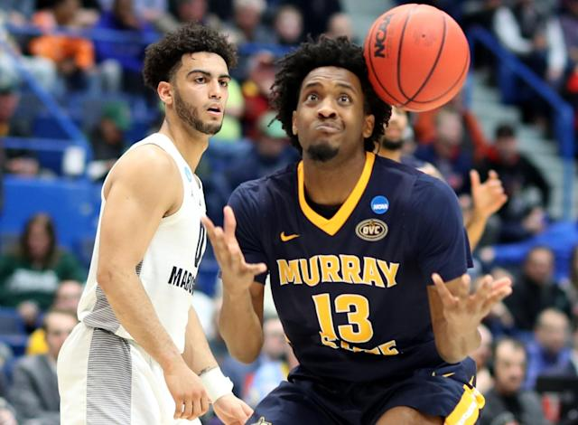 <p>Markus Howard #0 of the Marquette Golden Eagles watches as Devin Gilmore #13 of the Murray State Racers misses the ball during the first round game of the 2019 NCAA Men's Basketball Tournament at XL Center on March 21, 2019 in Hartford, Connecticut. (Photo by Rob Carr/Getty Images) </p>