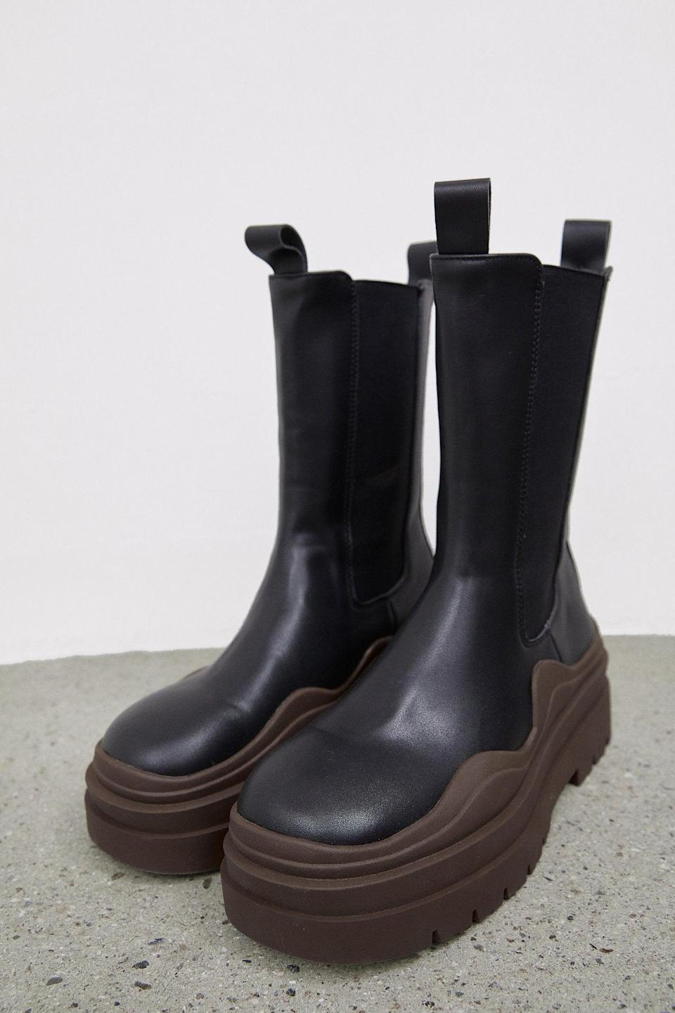 "<br><br><strong>The Source Unknown</strong> High Platform Ankle Boots, Brown & Black, $, available at <a href=""https://go.skimresources.com/?id=30283X879131&url=https%3A%2F%2Fthesourceunknown.com%2Fcollections%2Fshoes-bags%2Fproducts%2Fhigh-platform-ankle-boots-brown-black"" rel=""nofollow noopener"" target=""_blank"" data-ylk=""slk:The Source Unknown"" class=""link rapid-noclick-resp"">The Source Unknown</a>"
