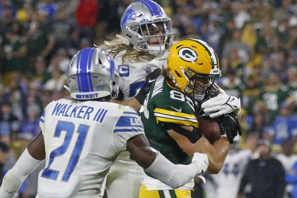Green Bay Packers' Robert Tonyan catches a touchdown pass between Detroit Lions' Tracy Walker III and Alex Anzalone during the second half of an NFL football game Monday, Sept. 20, 2021, in Green Bay, Wis. (AP Photo/Matt Ludtke)