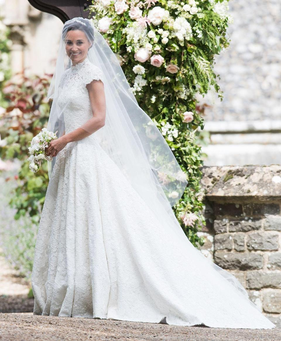 <p>Pippa Middleton drew a big audience on the day of her nuptials, with a lot of speculation about who would get to design the dress. British designer Giles Deacon held the baton on the day, creating this custom lace gown that wasn't totally dissimilar to her big sister Kate Middleton's dress. </p>