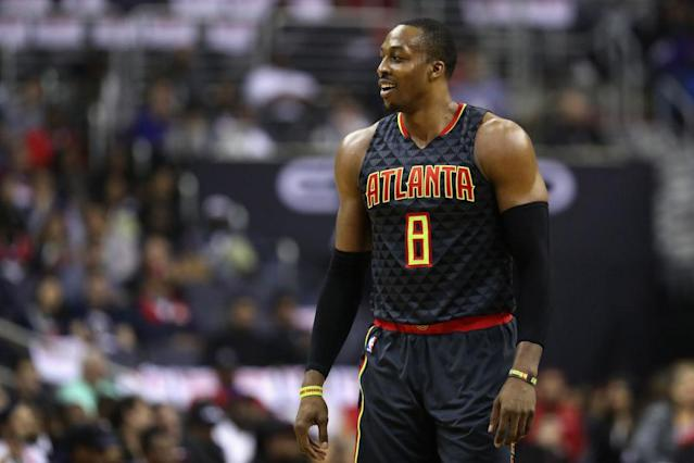 Dwight Howard looks on, trying to figure out how to turn things around. (Getty Images)