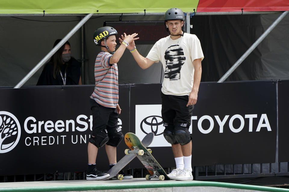 Hampus Winberg, of Sweden, talks with Yam Behar, of Israel, right, during practice at an Olympic qualifying skateboarding event at Lauridsen Skatepark, Wednesday, May 19, 2021, in Des Moines, Iowa. The questions under the magnifying glass at this week's Dew Tour — one of the last major qualifying events for the games in Tokyo in July — is whether the Olympics is ready for skateboarding and, more tellingly, whether skateboarding is ready for the Olympics. (AP Photo/Charlie Neibergall)