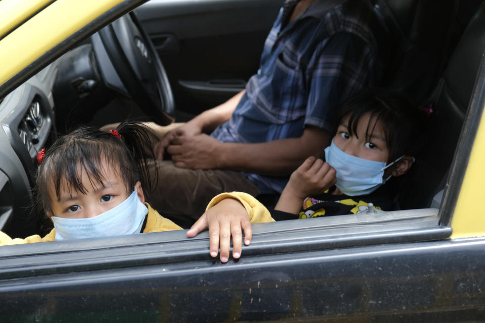Children look out from the window of a car in Kohima, capital of the northeastern Indian state of Nagaland, Friday, May 29, 2020. The state which was a green zone until earlier this week, now has 25 COVID positive cases. Most of the 150,000 cases are concentrated in five of India's 28 states, though an increase in cases has also been reported in some eastern states as migrant workers have begun arriving home from big cities on special trains. (AP Photo/Yirmiyan Arthur)