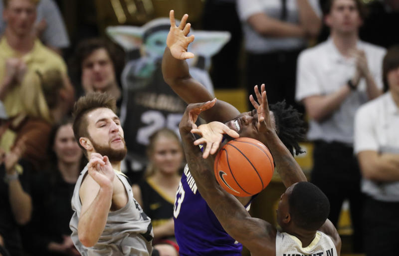 Washington forward Isaiah Stewart, center, fights for control of a rebound between Colorado guard McKinley Wright IV, front, and forward Lucas Siewert in the second half of an NCAA college basketball game Saturday, Jan. 25, 2020, in Boulder, Colo. (AP Photo/David Zalubowski)