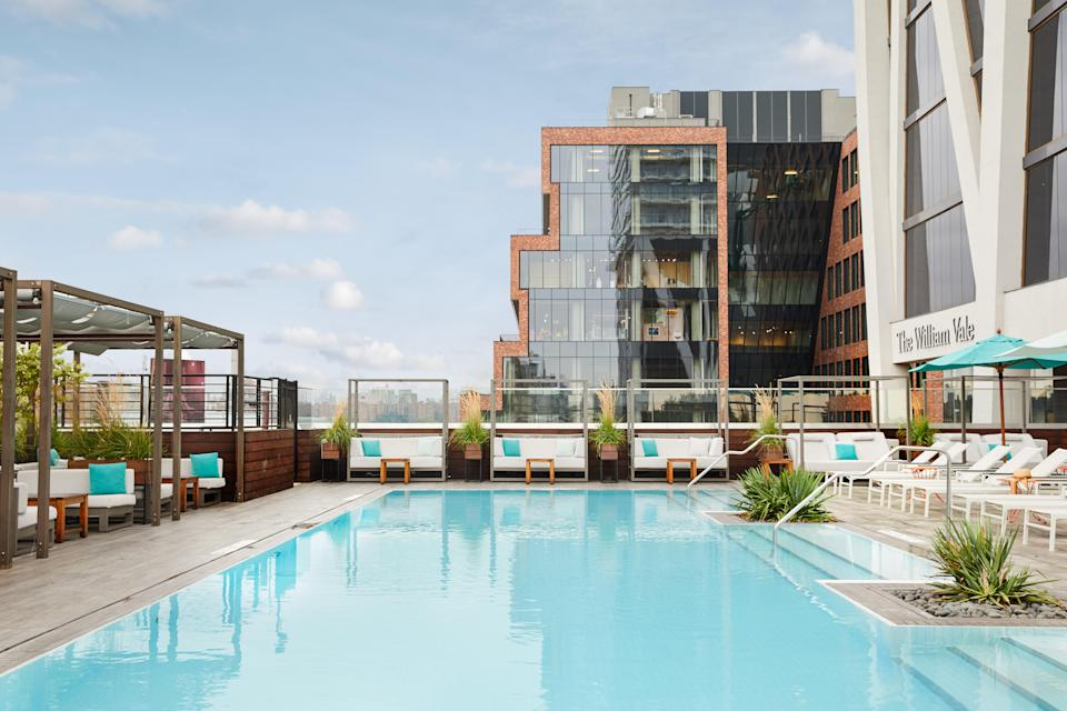 """<p>Take a load off at the largest outdoor hotel pool in <a href=""""https://www.cntraveler.com/gallery/williamsburg-brooklyn-guide?mbid=synd_yahoo_rss"""" rel=""""nofollow noopener"""" target=""""_blank"""" data-ylk=""""slk:Brooklyn"""" class=""""link rapid-noclick-resp"""">Brooklyn</a>, which offers pool access via ResortPass. There are two approaches at the <a href=""""https://www.cntraveler.com/hotels/united-states/new-york/william-vale?mbid=synd_yahoo_rss"""" rel=""""nofollow noopener"""" target=""""_blank"""" data-ylk=""""slk:William Vale"""" class=""""link rapid-noclick-resp"""">William Vale</a> (<em>rooms from $260</em>): the $100 Day Pass grants access during prime sun hours from 8 a.m. to 2 p.m.; and the Afternoon Pass for $75 allows access from 2:30 p.m. to 8 p.m. Just remember that the terrace is shaded in the afternoons, and is a bit more of a scene than the mornings—which feel like a quiet, sunny respite. Whichever you choose, it's still cheaper than a trip to the Hamptons.</p> <p><strong>Reserve a spot</strong>: <a href=""""https://www.resortpass.com/hotels/the-william-vale"""" rel=""""nofollow noopener"""" target=""""_blank"""" data-ylk=""""slk:resortpass.com"""" class=""""link rapid-noclick-resp"""">resortpass.com</a></p>"""