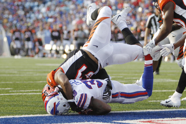 Buffalo Bills' Travaris Cadet (39) is tackled by Cincinnati Bengals' Brandon Bell (51) after crossing the goal line for a touchdown during the second half of a preseason NFL football game Sunday, Aug. 26, 2018, in Orchard Park, N.Y. (AP Photo/Jeffrey T. Barnes)