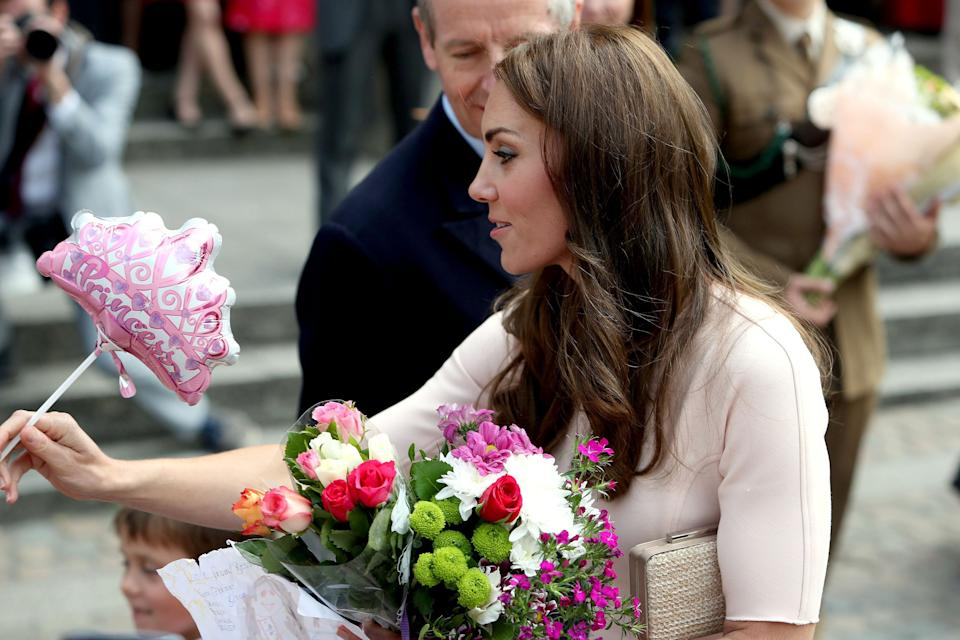 The Duchess of Cambridge receives flowers after departing Truro Cathedral at the start of a day-long tour of Cornwall.