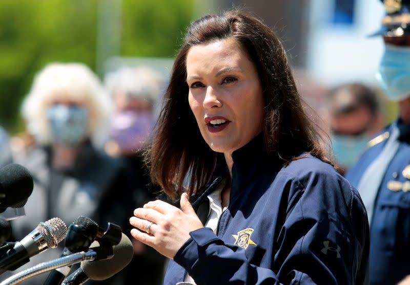 Michigan Governor Gretchen Whitmer addresses the media about the flooding along the Tittabawassee River, after several dams breached, in downtown Midland