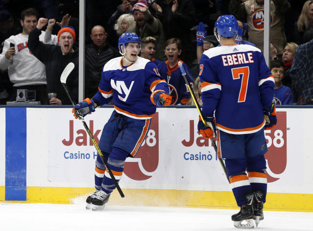 New York Islanders center Derick Brassard (10) celebrates his goal against the Anaheim Ducks with teammate Jordan Eberle (7) during the second period of an NHL hockey game, Saturday, Dec. 21, 2019, in Uniondale, N.Y. (AP Photo/Jim McIsaac)