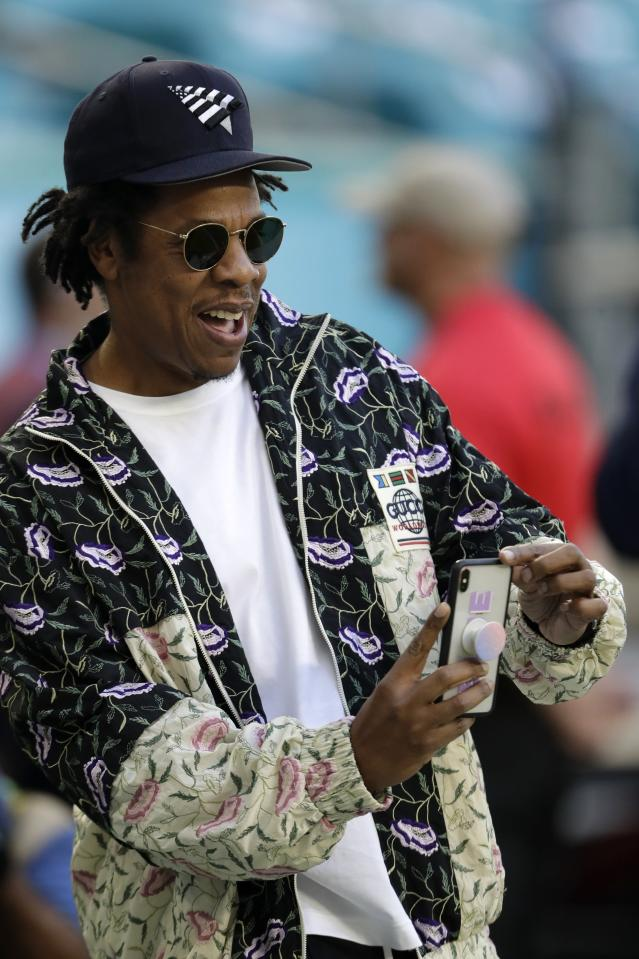 Entertainer Jay-Z makes a photo before the NFL Super Bowl 54 football game between the San Francisco 49ers and the Kansas City Chiefs, Sunday, Feb. 2, 2020, in Miami. (AP Photo/David J. Phillip)