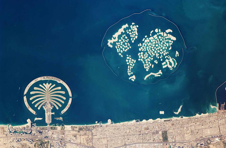 A clear shot of the artificial archipelagos of Dubai's Palm Jumeirah (left) and The World (right) taken from the International Space Station.