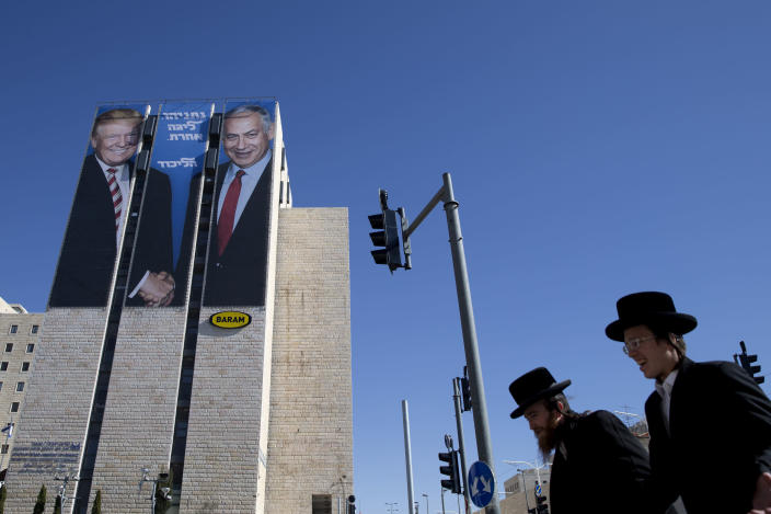 An election billboard in Jerusalem shows President Trump with Israeli Prime Minister Benjamin Netanyahu, in February. (Photo: Oded Balilty/AP)