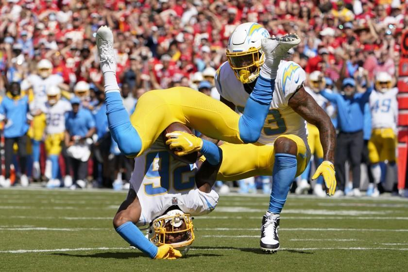 Los Angeles Chargers' Asante Samuel Jr. (26) makes an interception during the first half of an NFL football game against the Kansas City Chiefs, Sunday, Sept. 26, 2021, in Kansas City, Mo. (AP Photo/Ed Zurga)