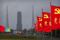 Flags with the logo of the Communist Party of China fly in the breeze near a launch pad at the Wenchang Space Launch Site in Wenchang in southern China's Hainan province, Monday, Nov. 23, 2020. Chinese technicians were making final preparations Monday for a mission to bring back material from the moon's surface for the first time in nearly half a century — an undertaking that could boost human understanding of the moon and of the solar system more generally. (AP Photo/Mark Schiefelbein)