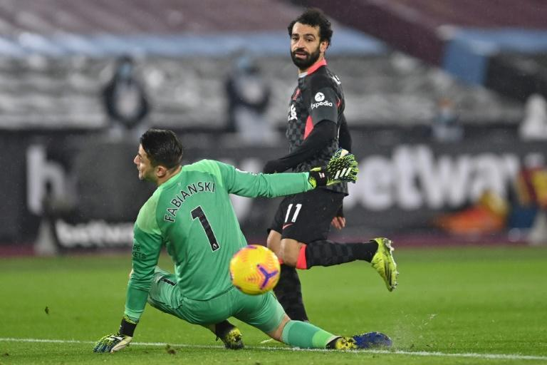 Mohamed Salah (R) scores his second goal for Liverpool against West Ham