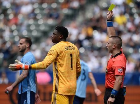 May 11, 2019; Carson, CA, USA; Match official Chris Penso issues a yellow card to Los Angeles Galaxy forward Zlatan Ibrahimovic (9) as New York City goalkeeper Sean Johnson (1) reacts during the second half at StubHub Center. Mandatory Credit: Gary A. Vasquez-USA TODAY Sports