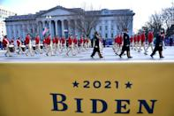 WASHINGTON, DC - JANUARY 20: Members of a marching band walk the abbreviated parade route following the inauguration of U.S. President Joe Biden on January 20, 2021 in Washington, DC. Biden became the 46th president of the United States earlier today during the ceremony at the U.S. Capitol. (Photo by Mark Makela/Getty Images)