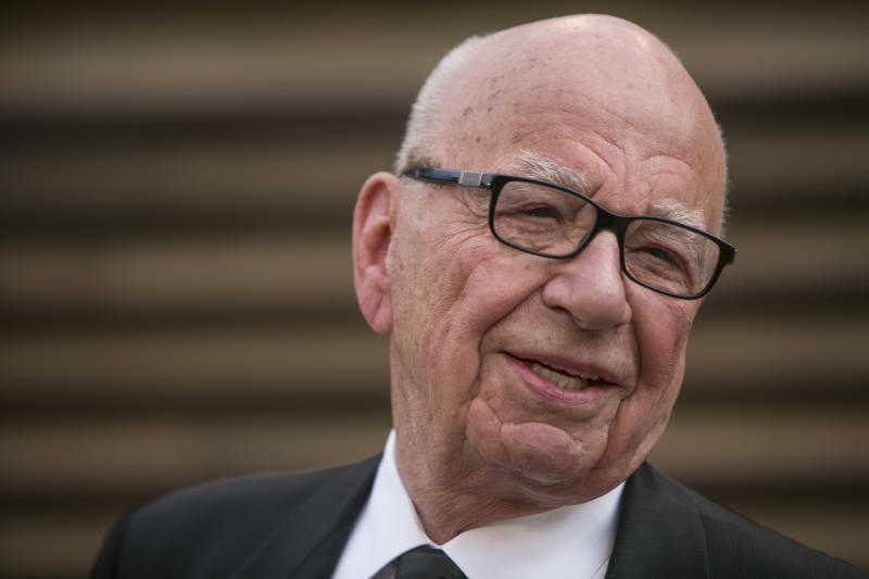 Rupert Murdoch arrives at the 2014 Vanity Fair Oscar Party on Sunday, March 2, 2014 in West Hollywood, California (AFP Photo/Adrian Sanchez-Gonzalez)