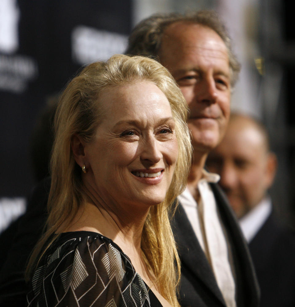 Cast member Meryl Streep smiles next to her husband Don Gummer at the premiere of