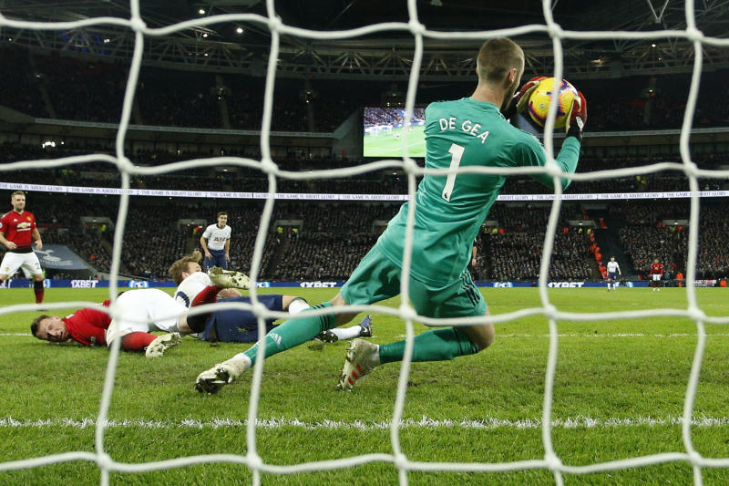 Manchester United goalkeeper David de Gea saves during the English Premier League soccer match between Tottenham Hotspur and Manchester United at Wembley stadium in London England Sunday Jan. 13 2019