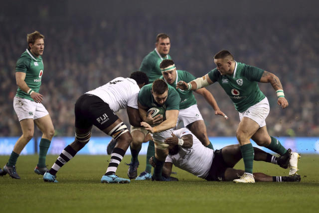 Ireland's Jack Conan, center, is tackled by Fiji's Levani Botia, center right, and Api Ratuniyarawa, center left, during their International Rugby Union match at the Aviva Stadium, Dublin, Saturday, Nov. 18, 2017. (Brian Lawless/PA via AP)