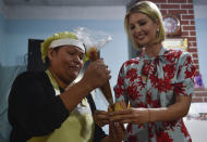 CORRECTS SPELLING OF ALCOCER - Ivanka Trump, President Donald Trump's daughter and White House adviser, holds a pastry as bakery owner Graciela Cristina Alcocer fills it with caramel as Ivanka Trump visits the bakery in Jujuy, Argentina, Thursday, Sept. 5, 2019. Ivanka Trump is on the second stop of her South America trip aimed at promoting women's empowerment. (AP Photo/Gustavo Garello)