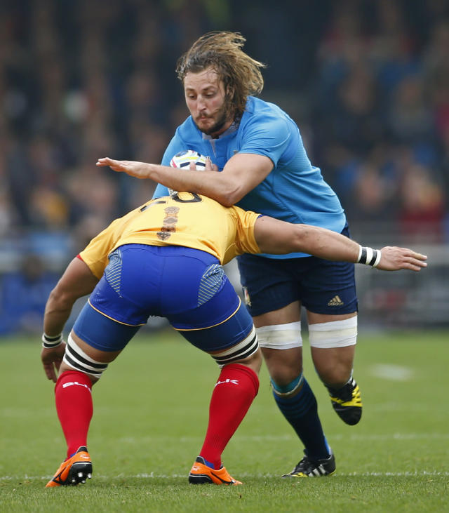Rugby Union - Italy v Romania - IRB Rugby World Cup 2015 Pool D - Sandy Park, Exeter, England - 11/10/15 Italy's Joshua Furno in action with Romania's Stelian Burcea Action Images via Reuters / Andrew Couldridge Livepic