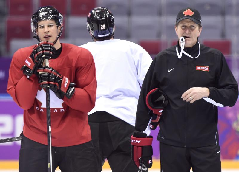 Team Canada captain Sidney Crosby, left, and head coach Mike Babcock, right, watch a drill during a practice session at the 2014 Sochi Winter Olympics in Sochi, Russia, on Monday, Feb. 10, 2014. (AP Photo/The Canadian Press, Nathan Denette)