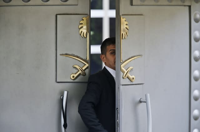 A security guard walks in the Saudi Arabia consulate in Istanbul (Lefteris Pitarakis/AP)
