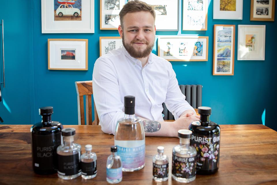 Bruce Walker with a selection of his gins (Elaine Livingstone/PA)