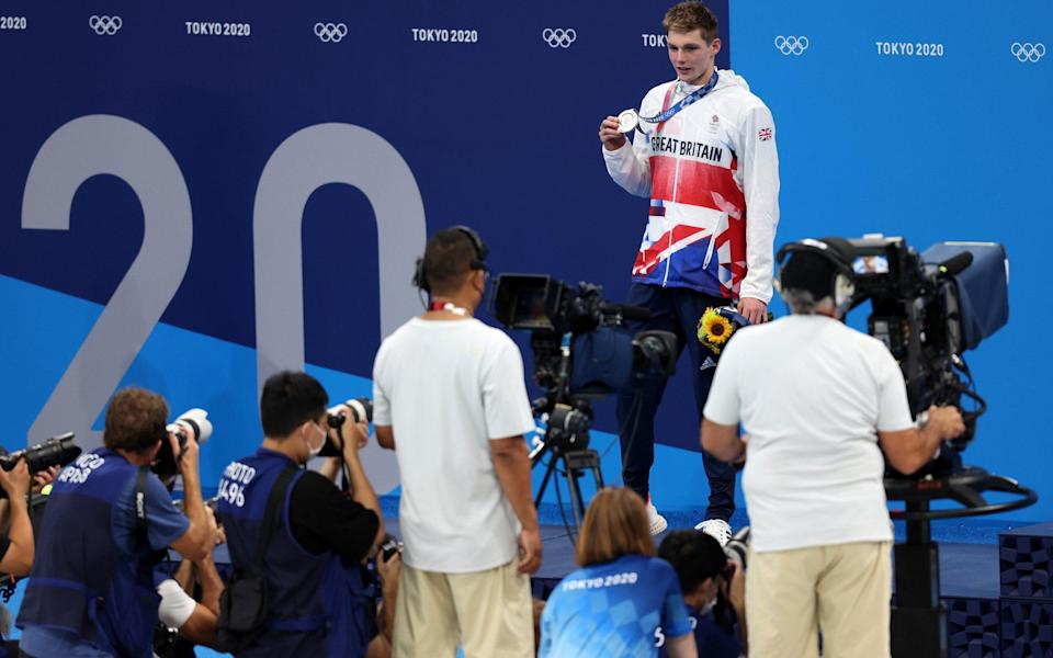 Silver medalist Duncan Scott of Team Great Britain reacts on the podium during the medal ceremony for the Men's 200m Individual Medley Final on day seven of the Tokyo 2020 Olympic Games at Tokyo Aquatics Centre on July 30, 2021 in Tokyo, Japan - Getty Images AsiaPac