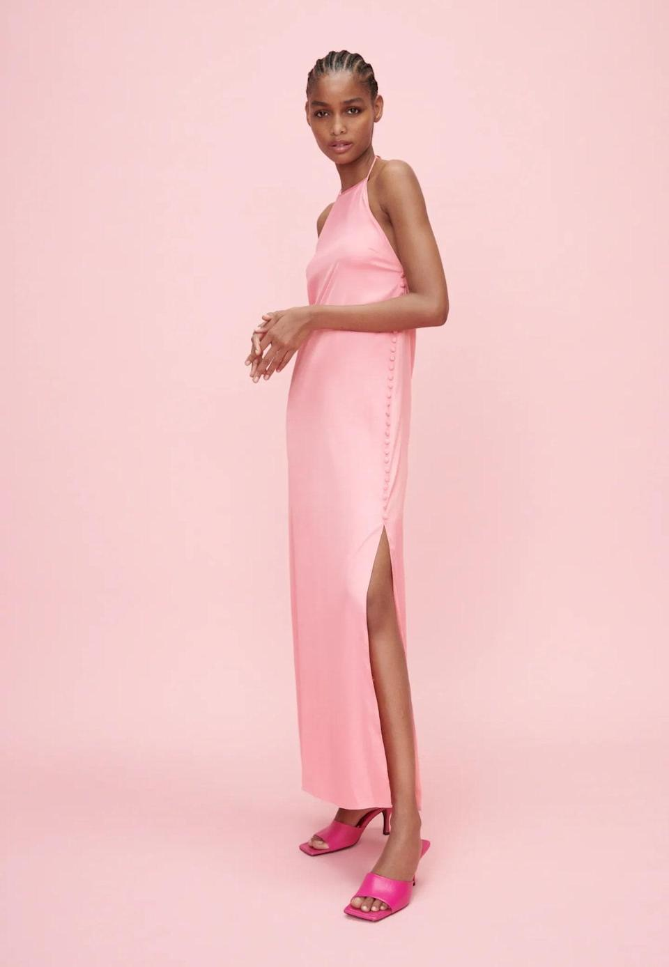 """Next up is this wispy number that looks way more expensive than the price tag would have you believe, thanks to the minimal cut and airy fit. (Those tiny side buttons are everything!) $46, Zara. <a href=""""https://www.zara.com/us/en/satin-effect-buttoned-dress-p04886421.html?v1=113470795"""" rel=""""nofollow noopener"""" target=""""_blank"""" data-ylk=""""slk:Get it now!"""" class=""""link rapid-noclick-resp"""">Get it now!</a>"""
