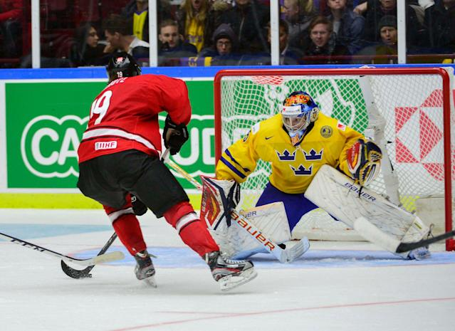 Switzerland's Flavio Schmutz in front of Sweden's goalkeeper Oscar Dansk during their IIHF World Junior Hockey Championship ice hockey game in Malmo December 26, 2013. REUTERS/Ludvig Thunman/TT News Agency (SWEDEN - Tags: SPORT ICE HOCKEY) ATTENTION EDITORS - THIS IMAGE WAS PROVIDED BY A THIRD PARTY. THIS PICTURE IS DISTRIBUTED EXACTLY AS RECEIVED BY REUTERS, AS A SERVICE TO CLIENTS. SWEDEN OUT. NO COMMERCIAL OR EDITORIAL SALES IN SWEDEN. NO COMMERCIAL SALES