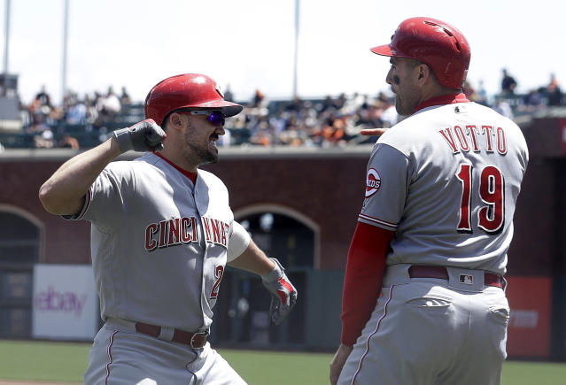Cincinnati Reds' Adam Duvall, left, is congratulated by Joey Votto after hitting a three-run home run that scored Votto and Scooter Gennett against the San Francisco Giants during the first inning of a baseball game in San Francisco, Wednesday, May 16, 2018. (AP Photo/Jeff Chiu)