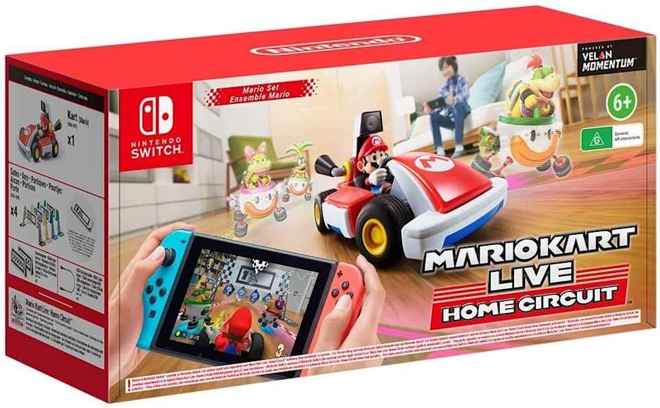 """<p><a class=""""link rapid-noclick-resp"""" href=""""https://www.amazon.co.uk/Mario-Kart-Live-Circuit-Nintendo/dp/B08HF7PBLJ?tag=hearstuk-yahoo-21&ascsubtag=%5Bartid%7C1923.g.22798845%5Bsrc%7Cyahoo-uk"""" rel=""""nofollow noopener"""" target=""""_blank"""" data-ylk=""""slk:SHOP"""">SHOP</a></p><p>Japanese gaming giants Nintendo have been dabbling with augmented reality for decades, and it hasn't always worked out for the best. Rest assured, though, that Mario Kart Live: Home Circuit is just as fun and subtly ground-breaking as it looks. The pack provides a kart and character (we got Mario, the standard, although other models are available), as well as cardboard props that enable you to create a track around your living space. The kart itself hosts a camera, which you can view through your Nintendo Switch screen as you race around rooms (using the Switch's controls). Different tracks within the game itself introduce AR enemies, power-ups, themes and obstacles, and while we haven't tried racing against other players yet, we assume it will equal measures fun and violent. A game that has the power to transport anyone right back to their childhood, by way of the laundry room.</p><p>Mario Kart Live: Home Circuit, £99, <a href=""""https://www.amazon.co.uk/Mario-Kart-Live-Circuit-Nintendo/dp/B08HF7PBLJ"""" rel=""""nofollow noopener"""" target=""""_blank"""" data-ylk=""""slk:amazon.co.uk"""" class=""""link rapid-noclick-resp"""">amazon.co.uk</a></p>"""