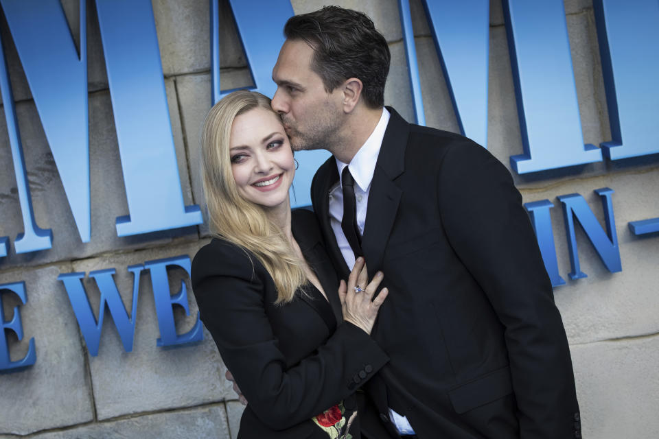 Amanda Seyfried and Thomas Sadoski pose for photographers upon arrival at the premiere of the film 'Mamma Mia! Here We Go Again', in London, Monday, July 16, 2018. (Photo by Vianney Le Caer/Invision/AP)