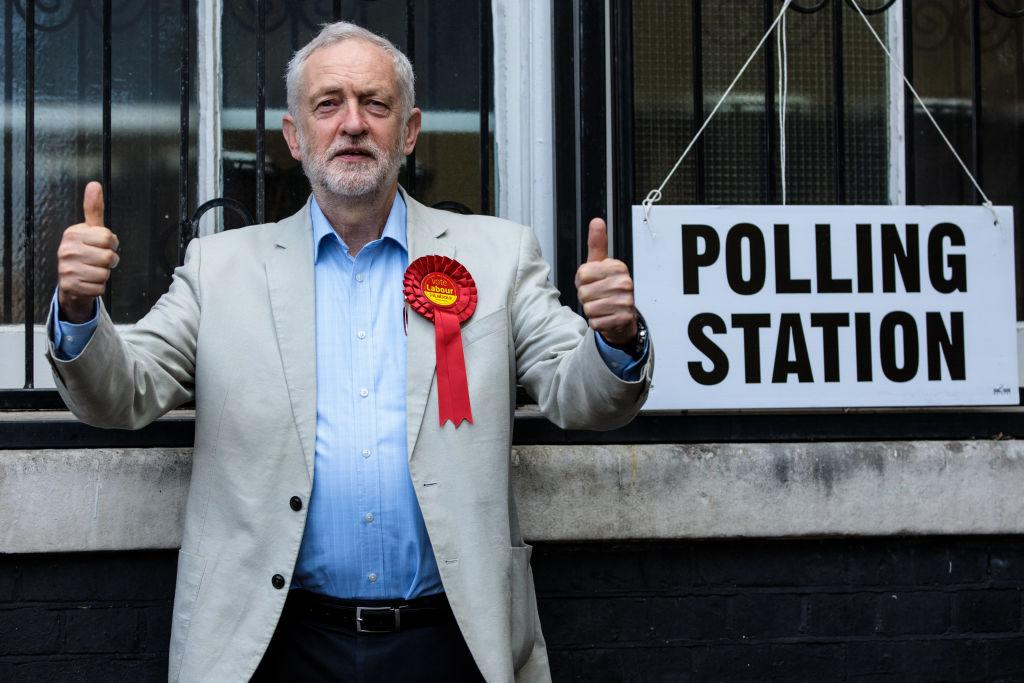 <p>Labour Leader Jeremy Corbyn poses by a sign after voting in local elections at a polling station at Pakeman Primary School in London, England. Voters are heading to the polls today for council and mayoral elections across England. These polls will be the first test of electoral opinion in England since last year's general election. (by Jack Taylor/Getty Images) </p>