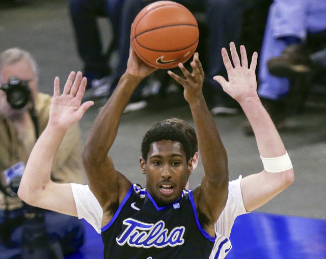 Tulsa Forward Rashad Smith, front, is guarded by Creighton center Will Artino, rear, in the first half of an NCAA college basketball game in Omaha, Neb., Saturday, Nov. 23, 2013. Creighton won 82-72. (AP Photo/Nati Harnik)