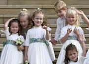 """<p>As part of the bridal party, little Savannah Phillips got to pose for <a href=""""https://www.harpersbazaar.com/celebrity/latest/a23763368/princess-eugenie-official-royal-wedding-portraits-cressida-bonas-taking-selfie/"""" rel=""""nofollow noopener"""" target=""""_blank"""" data-ylk=""""slk:official wedding photos"""" class=""""link rapid-noclick-resp"""">official wedding photos</a> alongside Princess Eugenie and Jack Brooksbank in October 2018. However, the royal was caught on camera with a glint in her eye as she subtly stood on the <a href=""""https://www.harpersbazaar.com/celebrity/latest/a23763666/princess-eugenie-royal-wedding-portraits-savannah-philips-bridesmaid/"""" rel=""""nofollow noopener"""" target=""""_blank"""" data-ylk=""""slk:bride's wedding dress train"""" class=""""link rapid-noclick-resp"""">bride's wedding dress train</a>. Naughty!</p>"""