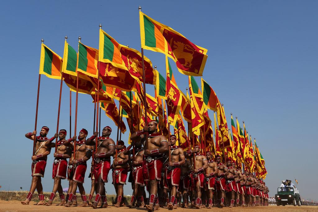 <p>Sri Lankan military carrying the national flags during the 70th Independence Day celebration rehearsal in Colombo, Sri Lanka. (Buddhika Weerasinghe/Getty Images) </p>