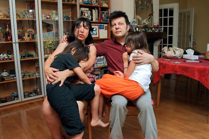 Sylvie and Dominique Mennesson, parents of twins born in 2000 from a surrogate mother from California, at their home in Maison Alfort, France on July 2, 2009 (AFP Photo/Pierre Verdy)