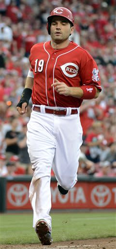 Cincinnati Reds' Joey Vottos scores on teammate Jack Hannahan's eighth-inning single during a baseball game against the Seattle Mariners at Great American Ball Park in Cincinnati, Saturday, July 6, 2013. The Reds won 13-4. (AP Photo/Michael E. Keating)