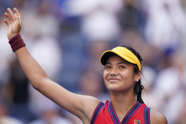 Emma Raducanu, of Britain, waves to the crowd after winning her match against Shelby Rogers, of the United States, in the fourth round of the US Open tennis championships, Monday, Sept. 6, 2021, in New York. (AP Photo/Seth Wenig)
