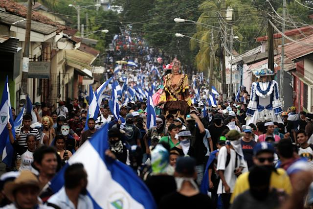 "<p>Protesters participate in the ""March of Mocking"" against Nicaraguan President Daniel Ortega and his wife, Vice President Rosario Murillo, in Leon, Nicaragua, on July 28, 2018. (Photo: Marvin Recinos/AFP/Getty Images) </p>"