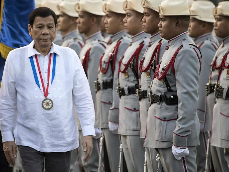 Philippines' President Rodrigo Duterte inspects the honour guards in Manila on 30 December 2017: Getty