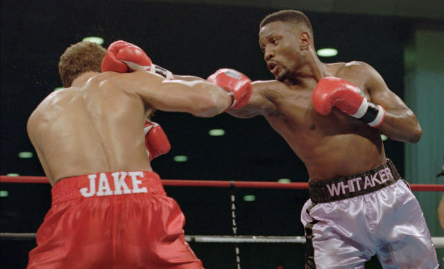 """FILE - In this Nov. 18, 1995, file photo, WBC welterweight champion Pernell """"Sweet Pea"""" Whitaker, right, delivers a right to the head of challenger Jake Rodriguez during their scheduled 12 round bout in Atlantic City, N.J. Former boxing champion Pernell Whitaker has died after he was hit by a car in Virginia. He was 55. Police in Virginia Beach on Monday say Whitaker was a pedestrian when struck by the car Sunday night, July 14, 2019. The driver remained on the scene, where Whitaker was pronounced dead. (AP Photo/Donna Connor, File)"""