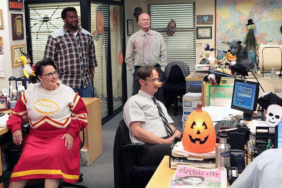 <p>Andy Bernard (dressed as George Michael) invites an a capella group, Here Comes Treble, from his alma mater, Cornell, to perform for the staff. Pam gets angry with Jim about an investment he made in a sports marketing company. Oh, and Dwight gets a pumpkin stuck on his head.</p><p><strong>Jim's Costume:</strong> None (he has an important meeting)</p>